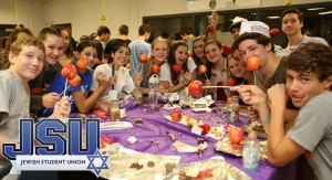"Over 1,500 teens attended Jewish Student Union of Atlanta (JSU) High Holiday programs this year. Rabbi Chaim Neiditch led educational sessions at a dozen local public high schools, where the main topics of focus were Rosh Hashana, Yom Kippur, and uniquely Jewish concepts such as tshuva (repentance). Rabbi Neiditch engaged the participants in rousing discussions during which the excitement of learning the deeper meanings of the High Holidays was palpable. Over and above the spiritual pleasures, the teens attending each JSU club event got a sweet taste of the New Year in the form of a ""dipping apple in honey"" activity. Sweet as honey may be, participants also got their thrills on from dipping apples into melted caramel and then rolling them in candied toppings like M&Ms and Rolos. It served as an especially tasty (and tasteful) way to have participants associate the High Holidays, which many of them were learning about for the first time, with something positive and enjoyable."